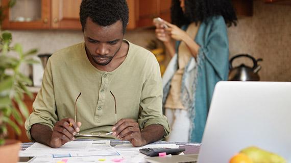 a man looking at installment loan options