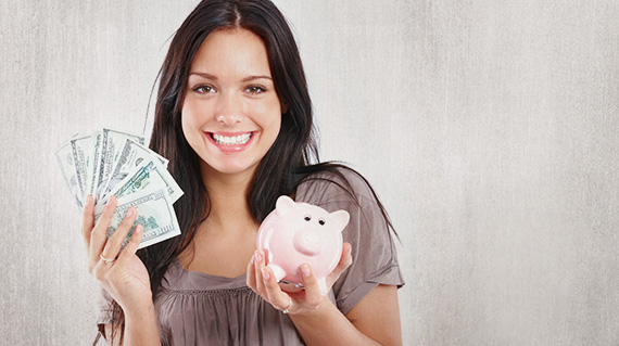 a woman holding cash from a cash advance or personal loan